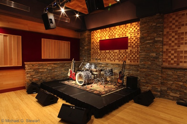 Recording studio stage with musical instruments, stonework, and woodwork