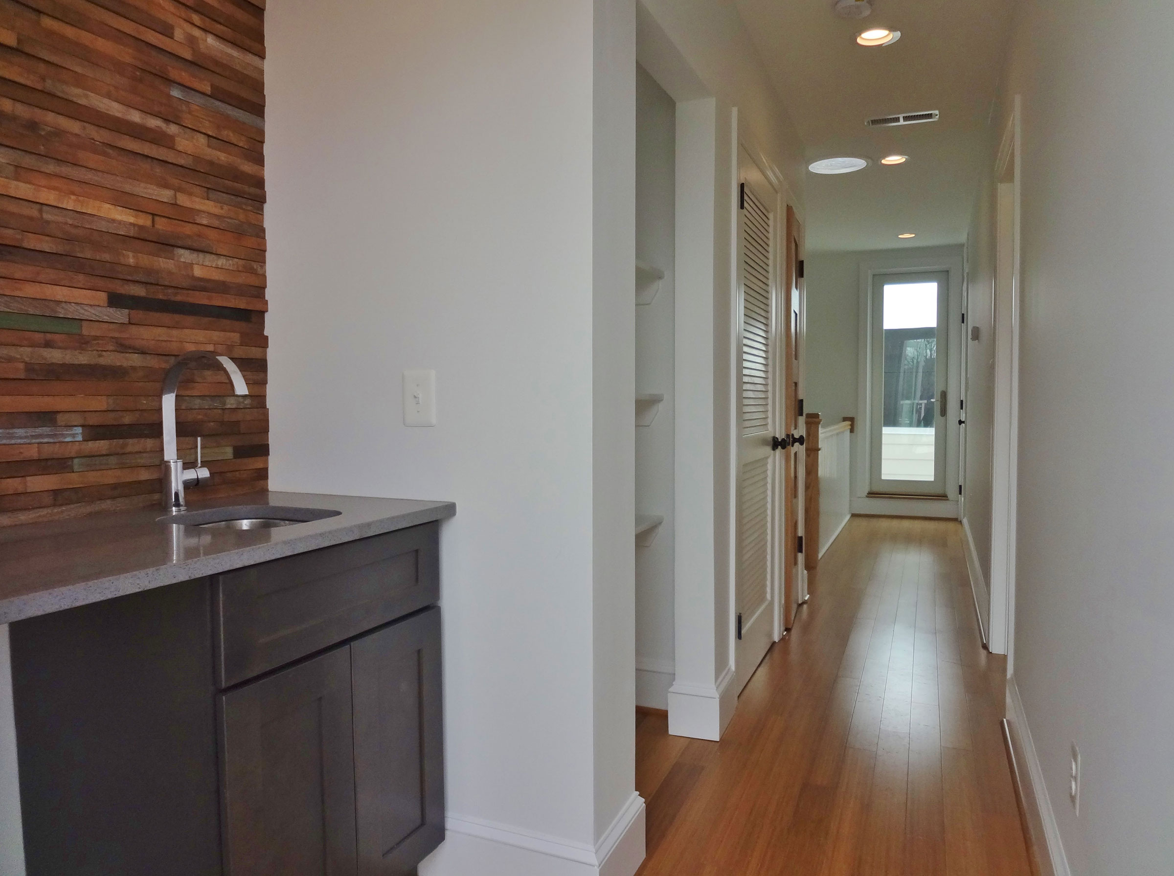 13-interior-hall-with-wet-bar-Opt
